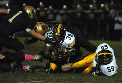 Hinsdale South junior running back Arian Toney (39) dives for the first down during a playoff game at Oak Forest on Friday, Oct. 26, 2012. Staff photo by Matthew Piechalak  |  Buy this photo at snapshots.mysuburbanlife.com/1557279
