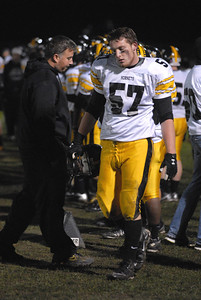 Players and coaches, including senior offensive lineman Peter Gebauer (57) look glum on the sideline after an Oak Forest touchdown that pushed the score to 29-0 during a playoff game on Friday, Oct. 26, 2012. Staff photo by Matthew Piechalak  |  Buy this photo at snapshots.mysuburbanlife.com/1557279