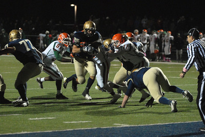 Lemont senior running back Christos Giatras (25) rushes in the red zone during a home playoff game against Morgan Park on Saturday, Oct. 27, 2012. Staff photo by Matthew Piechalak  |  Buy this photo at snapshots.mysuburbanlife.com/1557746