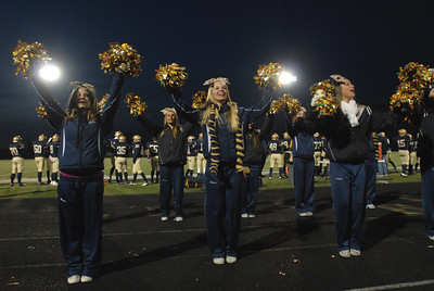 The Lemont Varsity Cheerleading team roots for the Indians during a home playoff game against Morgan Park on Saturday, Oct. 27, 2012. Staff photo by Matthew Piechalak  |  Buy this photo at snapshots.mysuburbanlife.com/1557746