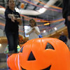 Jeff Krage – For the Kane County Chronicle<br /> Children play pumpkin buckets during Saturday's Halloween Hayday at Stephen Persinger Recreation Center.<br /> Geneva 10/27/12