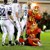 Batavia's Zachary Strittmatter sits on the ground after being stopped by the Downers Grove North defense as teammate Anthony Scaccia (28) looks on during the Bulldogs' playoff loss Friday night.