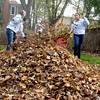 Batavia High School freshmen Megan Koif and Ivana Cortez rake leaves in Cindae Race's backyard Sunday afternoon for the Batavia United Way's Day of Caring.