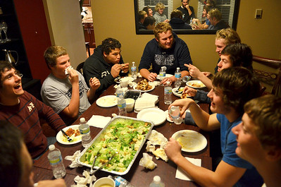 Monica Maschak - mmaschak@shawmedia.com Cary-Grove's offensive line eats dinner and converses around the table at the home of running back Ryan Mahoney Tuesday night.  A weekly dinner is hosted by the running back with the most yards from a recent game.  This week, Kyle Norberg and Mahoney were the hosts with 203 yards and 106 yards respectively.