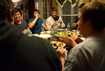 Monica Maschak - mmaschak@shawmedia.com Cary-Grove offensive linemen Kaene Connington (left), Ryan Mahoney and Jason Gregoire eat dinner and converse with their teammates at Mahoney's home in Cary on Tuesday, October 30, 2012.  Whichever Cary-Grove running back gains the most yards in a game has the offensive line over for dinner.  Kyle Norberg and Ryan Mahoney hosted the dinner at Mahoney's home after gaining 203 yards and 106 yards respectively during Saturday's win over Auburn.
