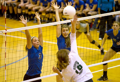 St. Charles North's Emily Belz (3) and Alex Stone (15) try to block a kill during their 23-25, 19-25 IHSA Class 4A Larkin Sectional semifinal loss against Glenbard West.