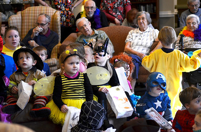 Monica Maschak - mmaschak@shawmedia.com Children from the Kids R Kids Schools & Academies in Crystal Lake sing Halloween songs to the residents of Autumn Leaves Alzheimer's & Memory Care on Wednesday, October 31, 2012.  The kids got to decorate candy bags and show off their costumes.