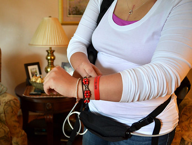 "Monica Maschak - mmaschak@shawmedia.com Weber wears a ""Hope for a New Heart"" bracelet. A fundraiser, respectively named, is being held next week to help off set her medical costs."