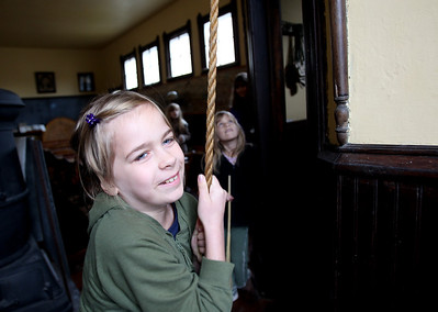Mike Greene - mgreene@shawmedia.com Elizabeth Martin, 9 of Marengo, pulls on the bell of a restored schoolhouse from 1895 as her sister Eileen, 6, watches during the 35th annual Cider Fest Sunday, October 7, 2012 at the McHenry County Historical Society Museum in Union. The annual event featured harvest demonstrations, displays and demonstrations of old tools, musical entertainment, barn raising, apple goodies bakery, white elephant sale and more.