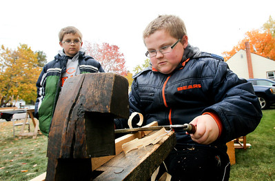 Mike Greene - mgreene@shawmedia.com Adam Parrott, 12 of Machesney Park, uses authentic tools to cut a wood board as his brother Alex, 11, watches on during the 35th annual Cider Fest Sunday, October 7, 2012 at the McHenry County Historical Society Museum in Union. The annual event featured harvest demonstrations, displays and demonstrations of old tools, musical entertainment, barn raising, apple goodies bakery, white elephant sale and more.
