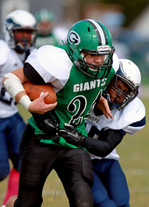 Sarah Nader - snader@shawmedia.com Alden-Hebron's Nick Beck (left) is tackled by Chicago Hope's Tyran Winston during the first quarter of Saturday's game in Hebron on October 20, 2012. Alden-Hebron won, 32-14.