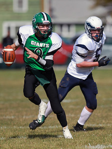 Sarah Nader - snader@shawmedia.com Alden-Hebron's Bryce Lalor (left) runs a play during the second quarter of Saturday's game against Chicago Hope in Hebron on October 20, 2012. Alden-Hebron won, 32-14.