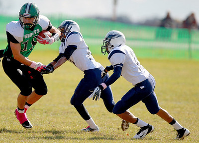 Sarah Nader - snader@shawmedia.com Alden-Hebron's Chip McKay (left) is tackled by Chicago Hope's Tristen Wesson and Xavier Sizer during the first quarter of Saturday's game in Hebron on October 20, 2012. Alden-Hebron won, 32-14.