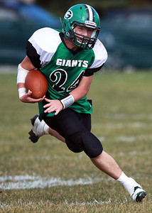 Sarah Nader - snader@shawmedia.com Alden-Hebron's Nick Beck runs a play during the second quarter of Saturday's game against Chicago Hope in Hebron on October 20, 2012. Alden-Hebron won, 32-14.