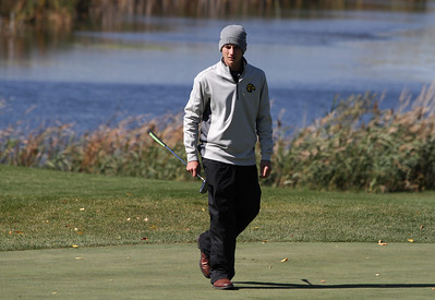 Mike Greene - mgreene@shawmedia.com Jacobs' Chris Boyle scouts the line for his putt on hole 11 during the Class 3A Barrington Sectional boys golf tournament Monday, October 8, 2012 at Makray Memorial Golf Course in Barrington.
