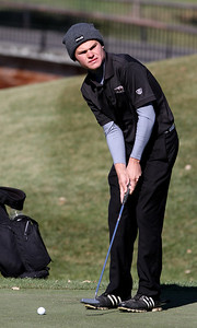 Mike Greene - mgreene@shawmedia.com Huntley's Trent Craig prepares to putt on hole 3 during the Class 3A Barrington Sectional boys golf tournament Monday, October 8, 2012 at Makray Memorial Golf Course in Barrington.