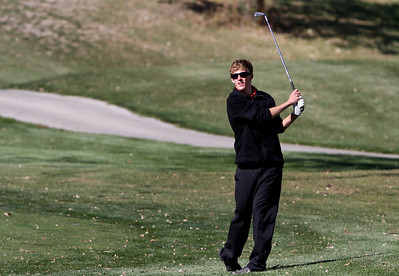 Mike Greene - mgreene@shawmedia.com McHenry's Anthony Mertz watches his approach shot on hole 3 during the Class 3A Barrington Sectional boys golf tournament Monday, October 8, 2012 at Makray Memorial Golf Course in Barrington.