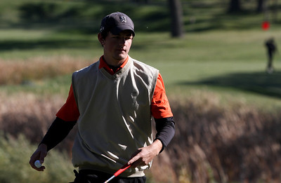 Mike Greene - mgreene@shawmedia.com McHenry's Andrew Reisinger walks off the green on hole 2 during the Class 3A Barrington Sectional boys golf tournament Monday, October 8, 2012 at Makray Memorial Golf Course in Barrington.