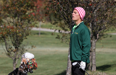 Mike Greene - mgreene@shawmedia.com Crystal Lake South's Austin Wiggerman peers over a hill to see his ball after a pitch shot on hole 11 during the Class 3A Barrington Sectional boys golf tournament Monday, October 8, 2012 at Makray Memorial Golf Course in Barrington.