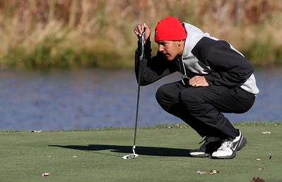 Mike Greene - mgreene@shawmedia.com Huntley's Riley Wicks lines up his putt on hole 4 during the Class 3A Barrington Sectional boys golf tournament Monday, October 8, 2012 at Makray Memorial Golf Course in Barrington.
