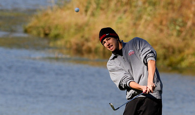 Mike Greene - mgreene@shawmedia.com Huntley's Brad Spoeth pitches onto the green on hole 3 during the Class 3A Barrington Sectional boys golf tournament Monday, October 8, 2012 at Makray Memorial Golf Course in Barrington.