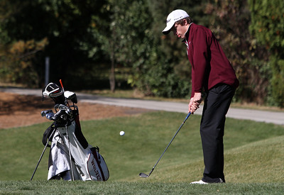 Mike Greene - mgreene@shawmedia.com Prairie Ridge's Connor Sullivan pitches onto the green on hole 13 during the Class 3A Barrington Sectional boys golf tournament Monday, October 8, 2012 at Makray Memorial Golf Course in Barrington.