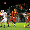 Batavia quarterback Micah Coffey throws a pass during their first-round playoff game against Downers Grove North Friday night in Batavia. (Sandy Bressner photo)
