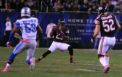 Sarah Nader - snader@shawmedia.com Chicago's Devin Hester (center) runs a play during the second quarter of Monday's game against the Detroit Lions in Chicago on October 22, 2012. Chicago won, 13-7.