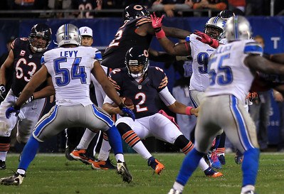 Sarah Nader - snader@shawmedia.com Chicago's Jason Campbell (center) runs the ball during the second quarter of  Monday's game against the Detroit Lions in Chicago on October 22, 2012. Chicago won, 13-7.