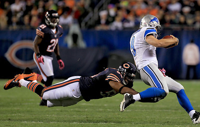 Sarah Nader - snader@shawmedia.com Chicago's Lance Briggs (left) sacks Detroit's quarterback Matthew Stafford during the second quarter of Monday's game at Solider Field in Chicago on October 22, 2012.