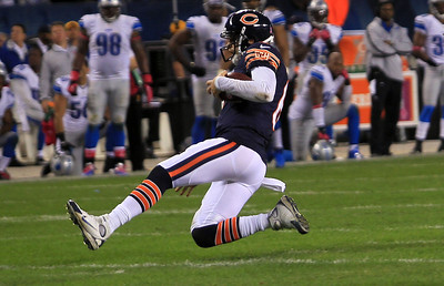 Sarah Nader - snader@shawmedia.com Chicago's Jay Cutler slides on the filed while running the ball during the second quarter of Monday's game against the Detroit Lions in Chicago on October 22, 2012. Chicago won, 13-7.