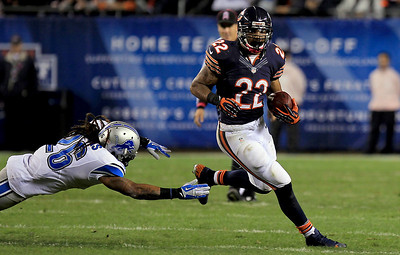 Sarah Nader - snader@shawmedia.com Chicago's Matt Forte runs pass Detroit's Louis Delmas during the first quarter of Monday's game at Solider Field in Chicago on October 22, 2012.