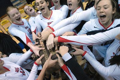 The Benet Varsity Girls Volleyball team celebrates a sectional title following a 25-14, 25-15 win over Lemont in the Class 4A Neuqua Valley Sectional Championship on Thursday, Nov. 1, 2012. Staff photo by Matthew Piechalak