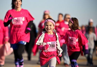 Josh Peckler - Jpeckler@shawmedia.com Jordan Villeneuve, 5 of Woodstock lets out a smile as she runs in the The 12th annual Care 4 Breast Cancer 5K Run/Walk at Woodstock North High School Sunday, October 21, 2012.