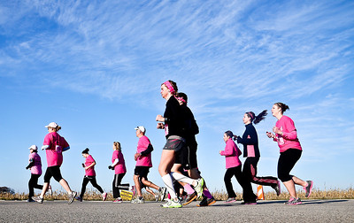 Josh Peckler - Jpeckler@shawmedia.com Runners dressed in pink attire participate in The 12th annual Care 4 Breast Cancer 5K Run/Walk at Woodstock North High School Sunday, October 21, 2012.