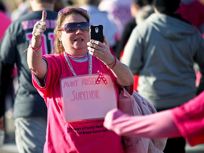 Josh Peckler - Jpeckler@shawmedia.com Cathie Anderson of Wonder Lake gives a thumbs up as she takes a picture with her phone during The 12th annual Care 4 Breast Cancer 5K Run/Walk at Woodstock North High School Sunday, October 21, 2012.