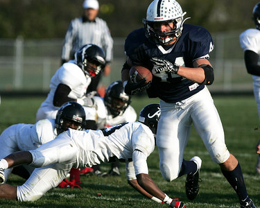 Monica Maschak - mmaschak@shawmedia.com Cary-Grove's Kyle Norberg runs the ball past four defensemen in a game against Auburn Saturday.  The Trojans defeated the Knights 41-7 in the first round of the IHSA Class 6A playoffs.