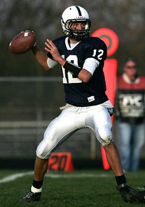 Monica Maschak - mmaschak@shawmedia.com Quarterback Jason Gregoire for Cary-Grove looks to pass the ball to an open teammate Saturday in a came against Auburn.  The Trojans won the first round of the playoffs 41-7.