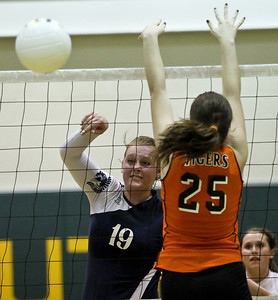 Josh Peckler - Jpeckler@shawmedia.com Cary-Grove's Mallory Wiczynski hits the ball past Crystal Lake Central's Rachael Schoepke during a first round regional match at Crystal Lake South High School Monday, October 22, 2012.