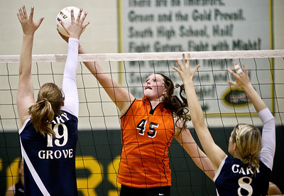 Josh Peckler - Jpeckler@shawmedia.com Crystal Lake Central's Lauren Leverenz tries to tip the ball past Cary-Grove blockers Mallory Wilczynski (19) and Abby Schebel during a first round regional match at Crystal Lake South High School Monday, October 22, 2012.