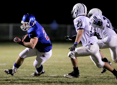 Sarah Nader - snader@shawmedia.com Dundee-Crown's Cody Lane (left) runs a play during the first quarter of Friday's game against Cary-Grove in Carpentersville on October 12, 2012.