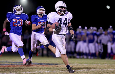 Sarah Nader - snader@shawmedia.com Cary-Grove's Kyle Norberg breaks away to score a touchdown in the second quarter of Friday's game against Dundee-Crown in Carpentersville on October 12, 2012. At half-time Cary-Grove was ahead 31-0.