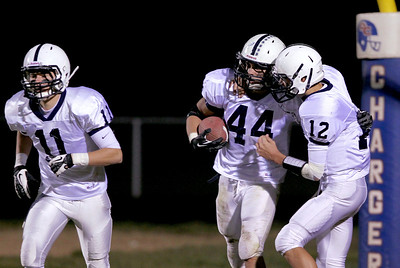 Sarah Nader - snader@shawmedia.com Cary-Grove's Kyle Norberg (left) celebrates his touchdown with Cary-Grove's Jason Gregoire during the second quarter of Friday's game against Dundee-Crown in Carpentersville on October 12, 2012.