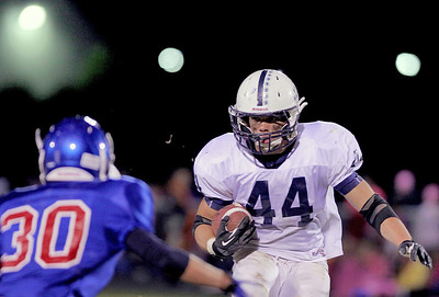 Sarah Nader - snader@shawmedia.com Dundee-Crown's Ben Sprouse (left) guards Cary-Grove's Kyle Norberg during the second quarter of Friday's game in Carpentersville on October 12, 2012.