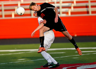 Josh Peckler - Jpeckler@shawmedia.com Mchenry's Sawyer Senn-Raemont heads the ball over a Cary-Grove defender during the first half of a IHSA regional semi-final game at Barrington High School Tuesday, October 16, 2012. Cary-Grove went on to defeat McHenry 2-0.
