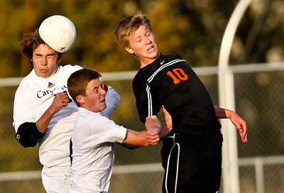 Josh Peckler - Jpeckler@shawmedia.com Mchenry's Sawyer Senn-Raemont (10) fights for a header from Cary-Grove's Mike McKune (left) and Brett Schuerg during the first half of a IHSA regional semi-final game at Barrington High School Tuesday, October 16, 2012. Cary-Grove went on to defeat McHenry 2-0.