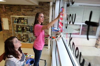 Mike Greene - mgreene@shawmedia.com Juniors Mary Stoppenbach (left), 17, and Rebekah West, 16, work on a junior class window during window decorations for homecoming Wednesday, October 3, 2012 at Cary-Grove High School in Cary. Homecoming festivities will culminate in parades Saturday morning before a varsity home football game against Huntley at 1PM.