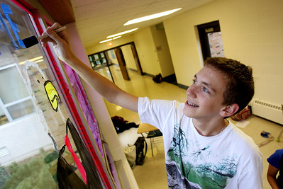 Mike Greene - mgreene@shawmedia.com Sophomore Jimmy Vitullo, 15, puts a label over an bald eagle while working on a window for the business club during window decorations for homecoming Wednesday, October 3, 2012 at Cary-Grove High School in Cary. Homecoming festivities will culminate in parades Saturday morning before a varsity home football game against Huntley at 1PM.
