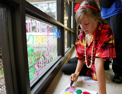 Mike Greene - mgreene@shawmedia.com Junior Anna Ivarson, 16, works on a window for the student newspaper during window decorations for homecoming Wednesday, October 3, 2012 at Cary-Grove High School in Cary. Homecoming festivities will culminate in parades Saturday morning before a varsity home football game against Huntley at 1PM.