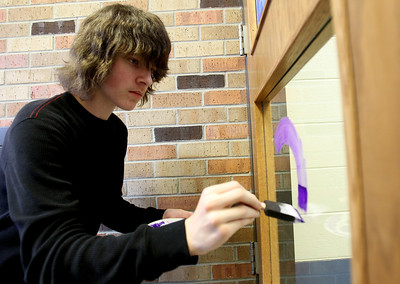 Mike Greene - mgreene@shawmedia.com Sophomore Derek Holtz, 15, works on a window for scholastic bowl during window decorations for homecoming Wednesday, October 3, 2012 at Cary-Grove High School in Cary. Homecoming festivities will culminate in parades Saturday morning before a varsity home football game against Huntley at 1PM.